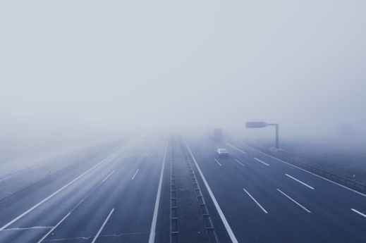 black car on hi way with fog